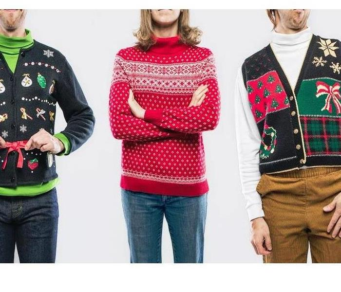 people lined up wearing winter sweaters