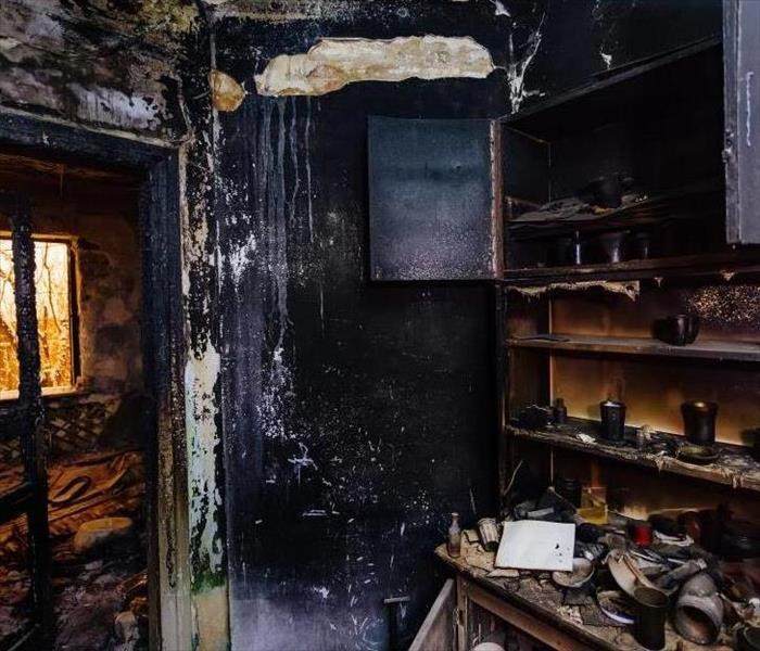 burned furniture, kitchen cabinet, charred walls and ceiling in black soot