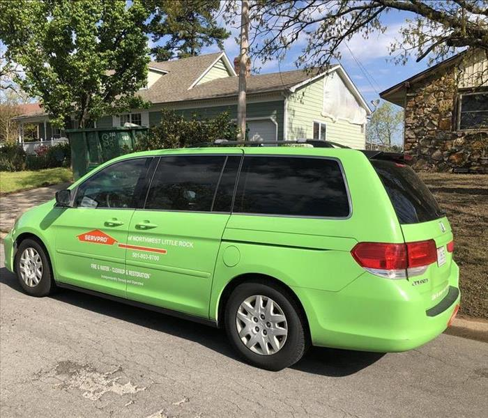 SERVPRO sales vehicle parked at job