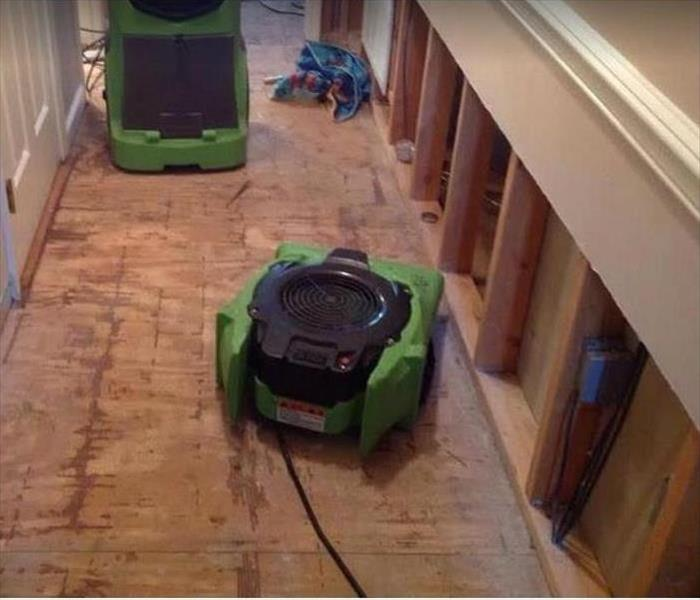 SERVPRO drying equipment on water damaged floor